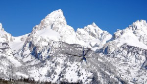 A helicopter heads toward Garnet Canyon in April during a search for two lost skiers in Grand Teton National Park. (National Park Service photo by Jackie Skaggs - click to enlarge)