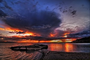 The sun casts a dramatic glow over Yellowstone Lake. (photo ©Leon Jenson — click to enlarge)